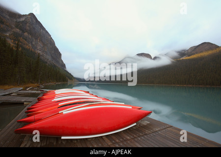 Canoe docks at Lake Louise on a cloudy summer day in Banff National Park Alberta Canada - Stock Photo