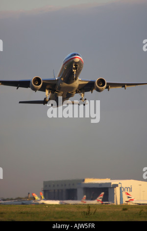 American Airlines Boeing 777 taking off from runway 27R at London Heathrow Airport, UK - Stock Photo