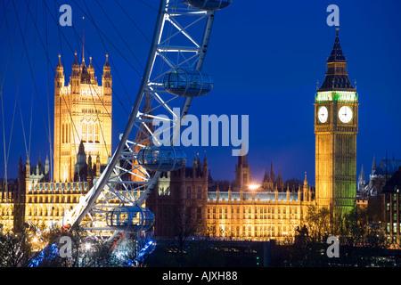 UK London Big Ben and Houses of parliament viewed through the BA London Eye at dusk - Stock Photo