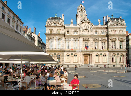 Pavement cafe in front of the Hotel de Ville, Place des Terreaux, Presqu'ile, Lyon, Rhone Valley, France - Stock Photo