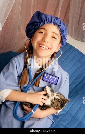 Front view of girl sitting with cats - Stock Photo