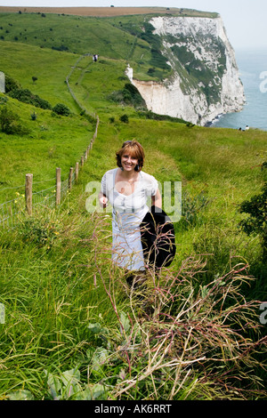 A girl on the white cliffs of Dover. - Stock Photo