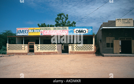 Typical small dukas or shops in the remote desert town of Lodwar in northern Kenya East Africa - Stock Photo