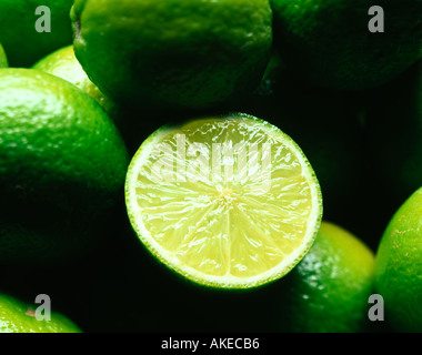 Fresh Limes one cut to show flesh - Stock Photo