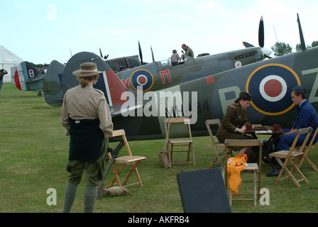 Spitfire Mark IXB on Ground With Mark VIII in Background and Crew at Goodwood Revival Meeting 2005 - Stock Photo