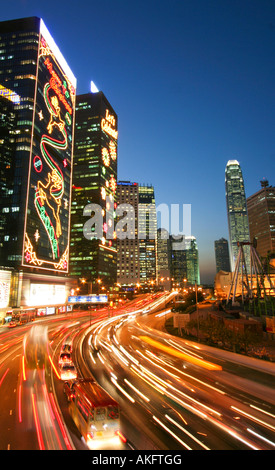 Skyscrapers and traffic trails in Hong Kong's Admiralty district. - Stock Photo