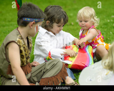 Children playing pass the parcel - Stock Photo
