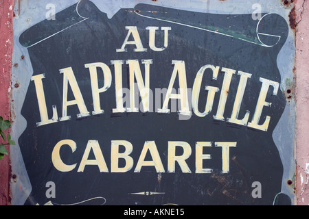 Sign at Au Lapin Agile cabaret began here in 1860 poets and singers still perform here Montmartre Paris France - Stock Photo