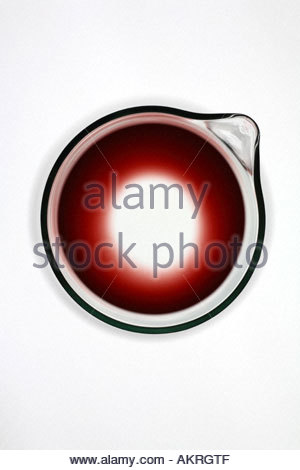 Close-up of red wine left in glass decanter. - Stock Photo