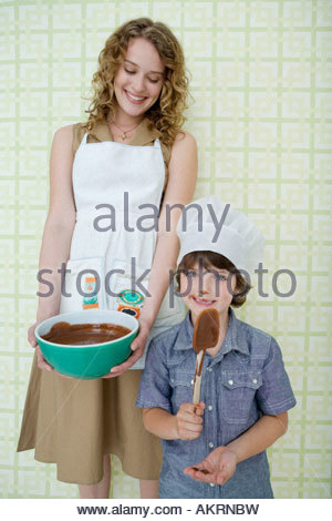 Mother and son with bowl of melted chocolate - Stock Photo