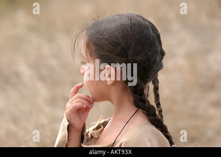 A young Native American Sioux Indian boy in South Dakota during the fall season thinking - Stock Photo