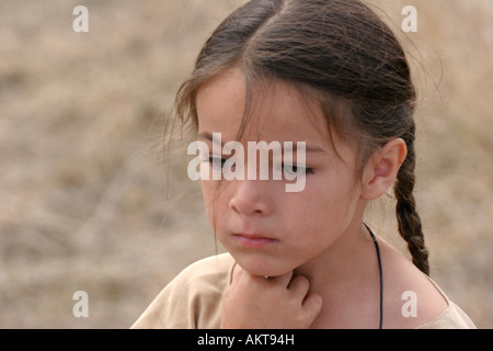 A male portrait of a young Native American Sioux Indian boy in South Dakota during the fall season - Stock Photo