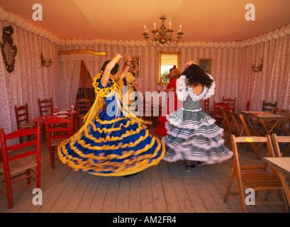 SPAIN Andalusia Seville April Fair or Feria de abril de Sevilla Four young girls Flamenco dancing in room of caseta - Stock Photo