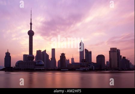 Shanghai Skyline viewed over the Huangpu River, China - Stock Photo