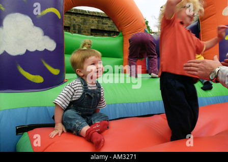 Young children and toddlers playing on soft play area. - Stock Photo