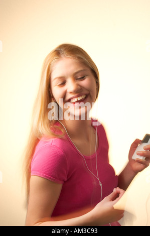 teenage girl listening to music and dancing - Stock Photo