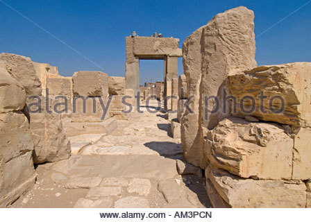 View towards peristyle court and granite gate inside Ramesses 11 Temple short walk from Osireion of Sethos at Abydos - Stock Photo