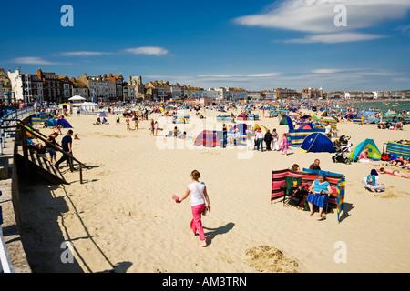 People sunbathing on Weymouth beach in summer, Dorset coast, England, UK - Stock Photo