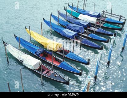 Eight docked gondolas in Venice. - Stock Photo