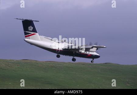BA DHC 7 10 Dash Seven on Shetland Isles Approach GAV 1015 - Stock Photo