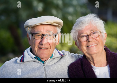 Portrait of a senior couple in a park. - Stock Photo