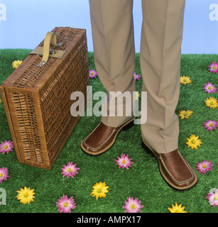 Businessman with picnic basket - Stock Photo