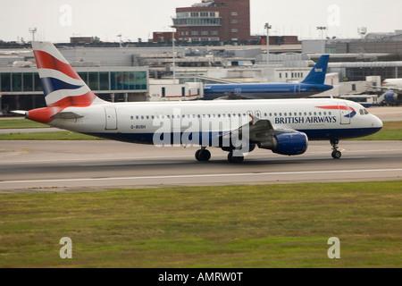 BA British Airways airbus a320 landing at London Heathrow LHR - Stock Photo