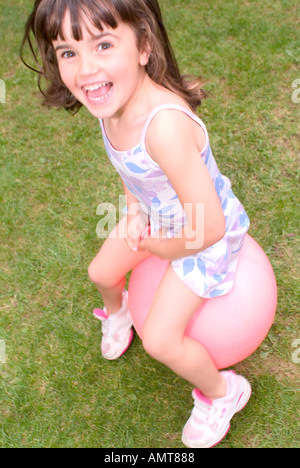 small girl on space hopper - Stock Photo