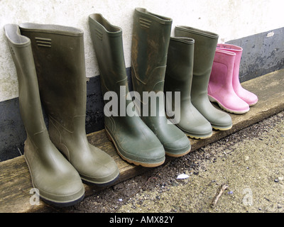 Families dirty wellington boots - Stock Photo