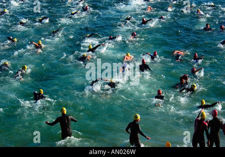 swimmers in a triathlon - Stock Photo
