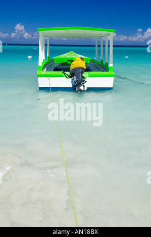 Colorful boat Seven mile beach Negril Jamaica - Stock Photo