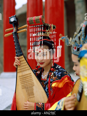 Women Dressed in Traditional Costume Playing  Three Stringed Lute, Beijing, China - Stock Photo