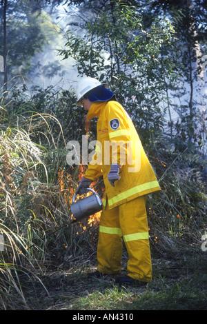 Volunteer Rural Fire Service Firefighter doing some backburning, Australia. - Stock Photo