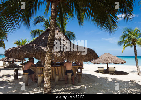 Beach Bar at Couples Swept Away Resort, Seven Mile Beach, Long Bay, Negril, Jamaica, Caribbean, West Indies - Stock Photo