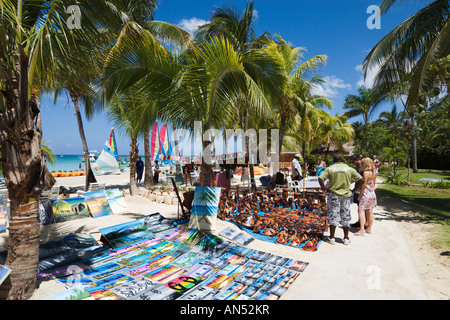 Locals selling paintings and carvings at Couples Swept Away Resort, Seven Mile Beach, Long Bay, Negril, Jamaica, - Stock Photo