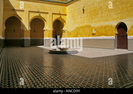 Central Fountain courtyard at Moulay Ismail Mausoleum Meknes Morocco - Stock Photo