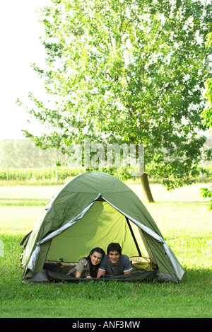 Friends in tent together - Stock Photo