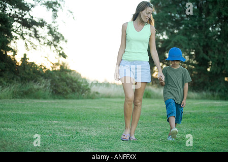 Mother and son, walking hand in hand - Stock Photo