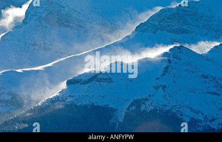 Sofa Mountain. Wind blowing snow from ridges. Wind in this area can reach over 100 kilometers per hour, Waterton - Stock Photo