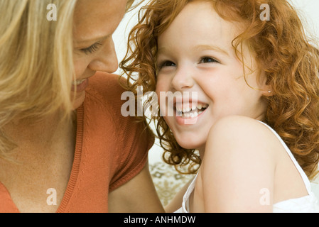 Mother and daughter laughing together, close-up - Stock Photo
