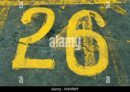 Number 26 painted on asphalt - Stock Photo