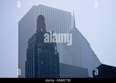 A view of the top of the famous Carbide and Carbon Amoco and AON Center buildings in Chicago Illinois USA from below - Stock Photo