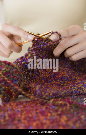 Close up of woman knitting - Stock Photo