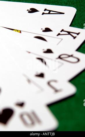 Straight flush poker hand in Spades (1) - Stock Photo