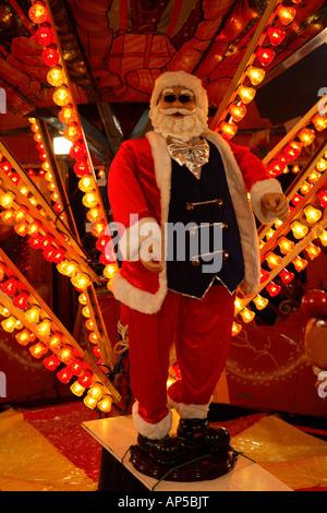 Christmas plastic Santa Claus at a fun fair, Cardiff Winter Wonderland, Cathys Park, Cardiff, South Wales, UK. - Stockfoto