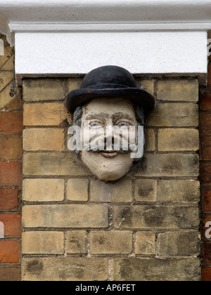 Masque above cottages in Victoria Street, Southwold - Stock Photo