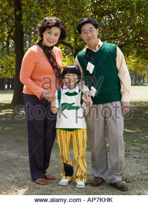 Portrait of grandparents with grandson - Stock Photo