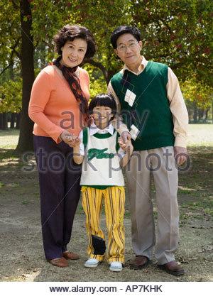 Portrait of grandparents with grandson - Stock Photo