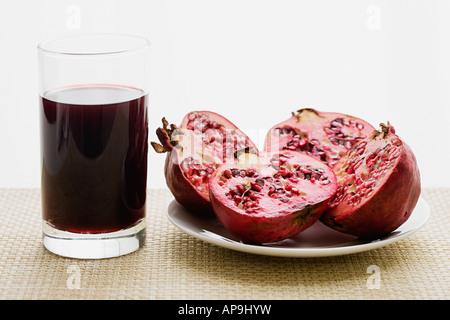 Pomegranates and pomegranate juice - Stock Photo