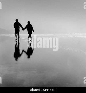 Romantic couple on Bude beach Cornwall UK - Stock Photo